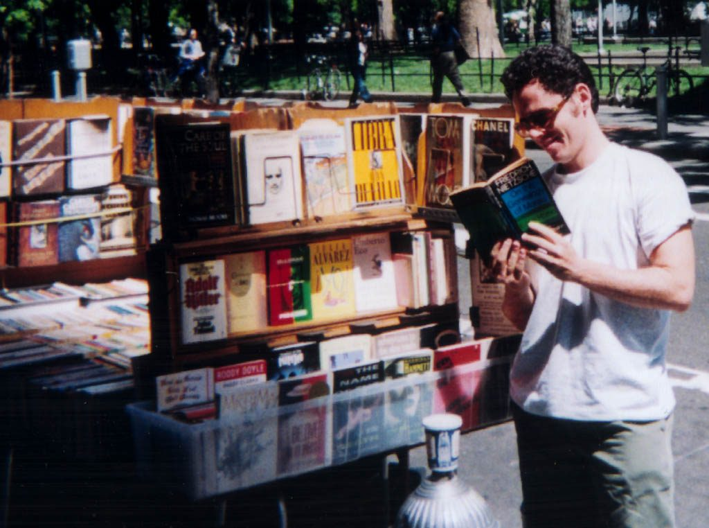 Reading Nietzsche at a sidewalk bookstand in Manhattan, from 'BookWars'