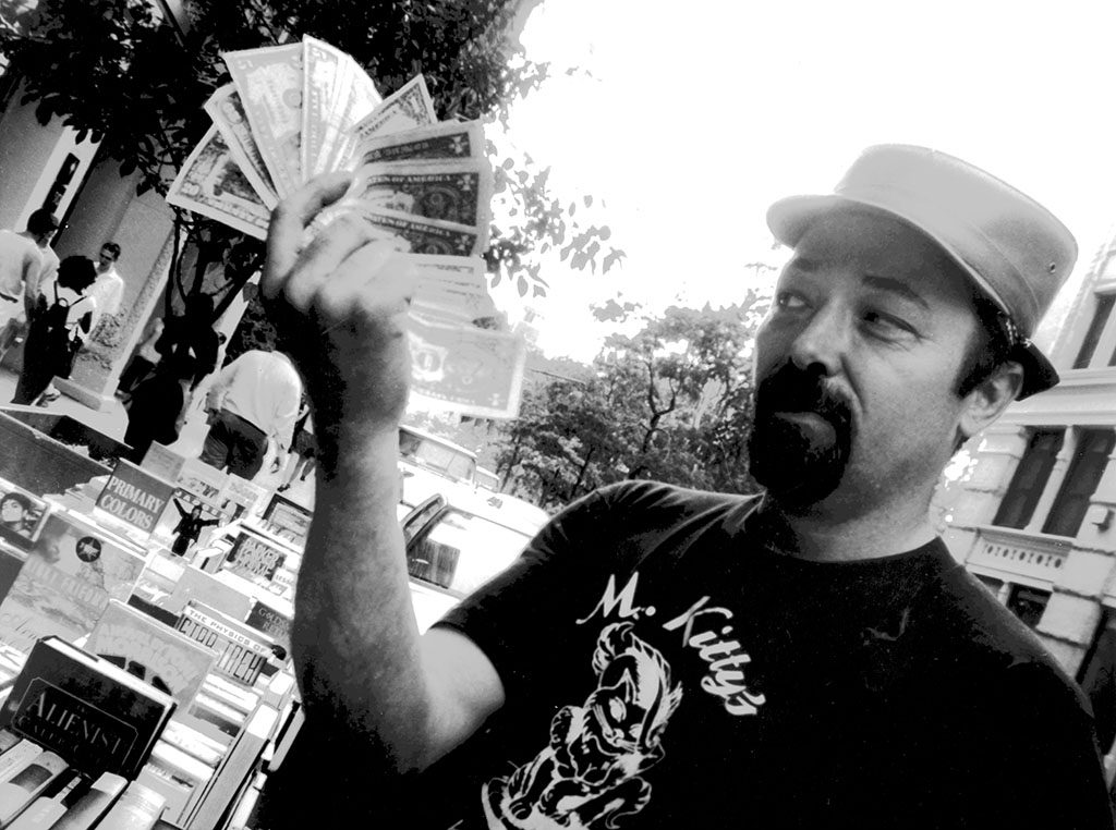 Street bookseller Pete shows off his cash in the NYC feature movie, 'BookWars'
